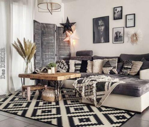 living room, grey floor, white black patterned rug, white wall, grey sofa, wooden table, white pendant