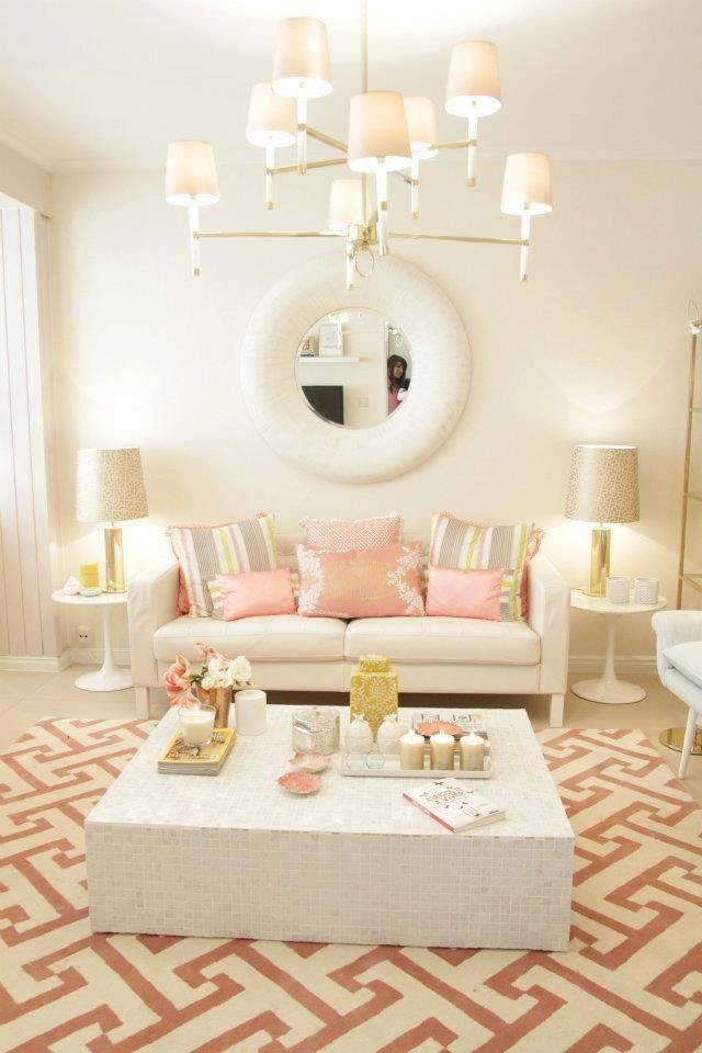 living room, patterned rug, white wall, traditional pendant, white coffee table, white sofa, white side table,