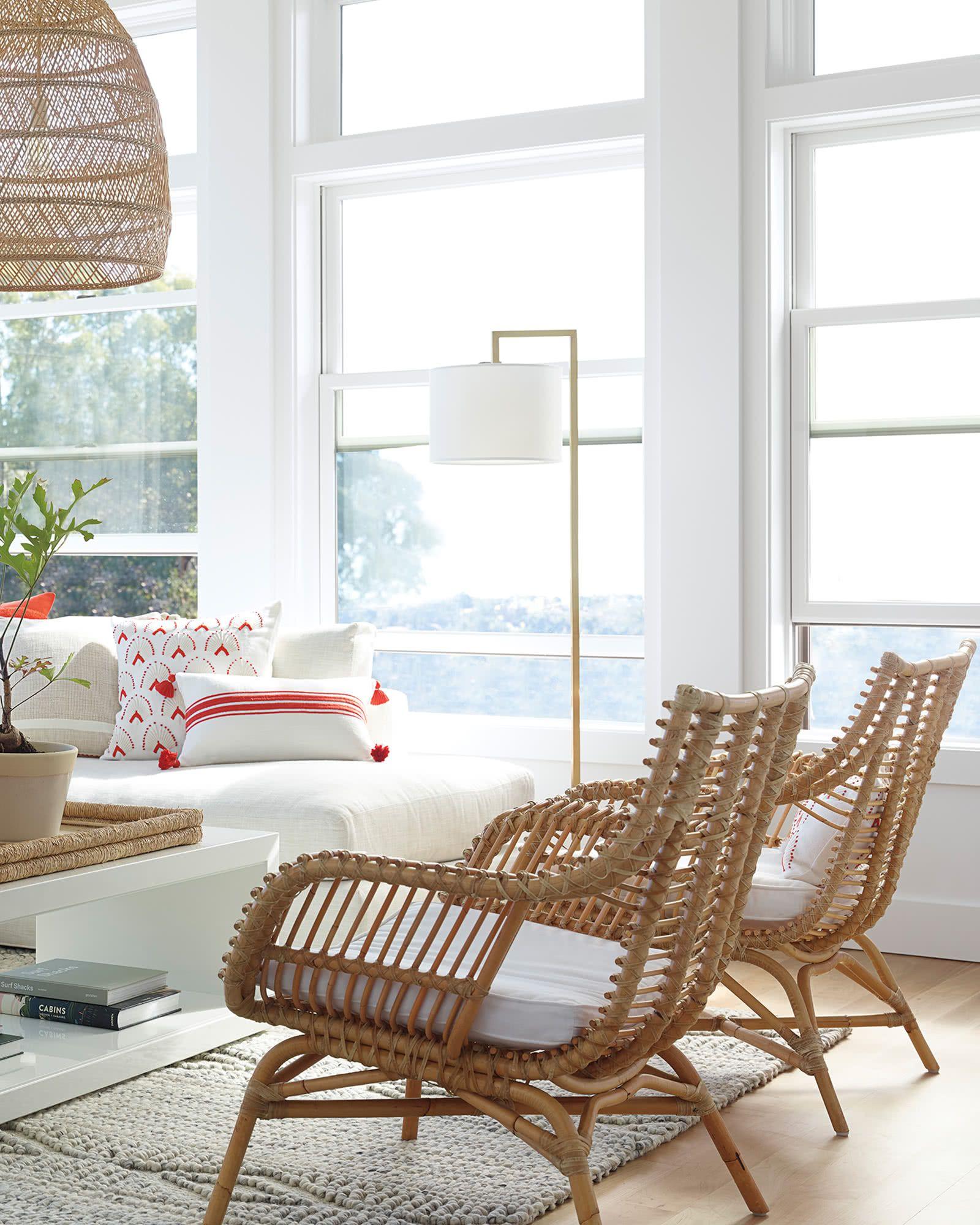 living room, rattan pendant, white sofa, rattan chair, white coffee table, white floor lamp