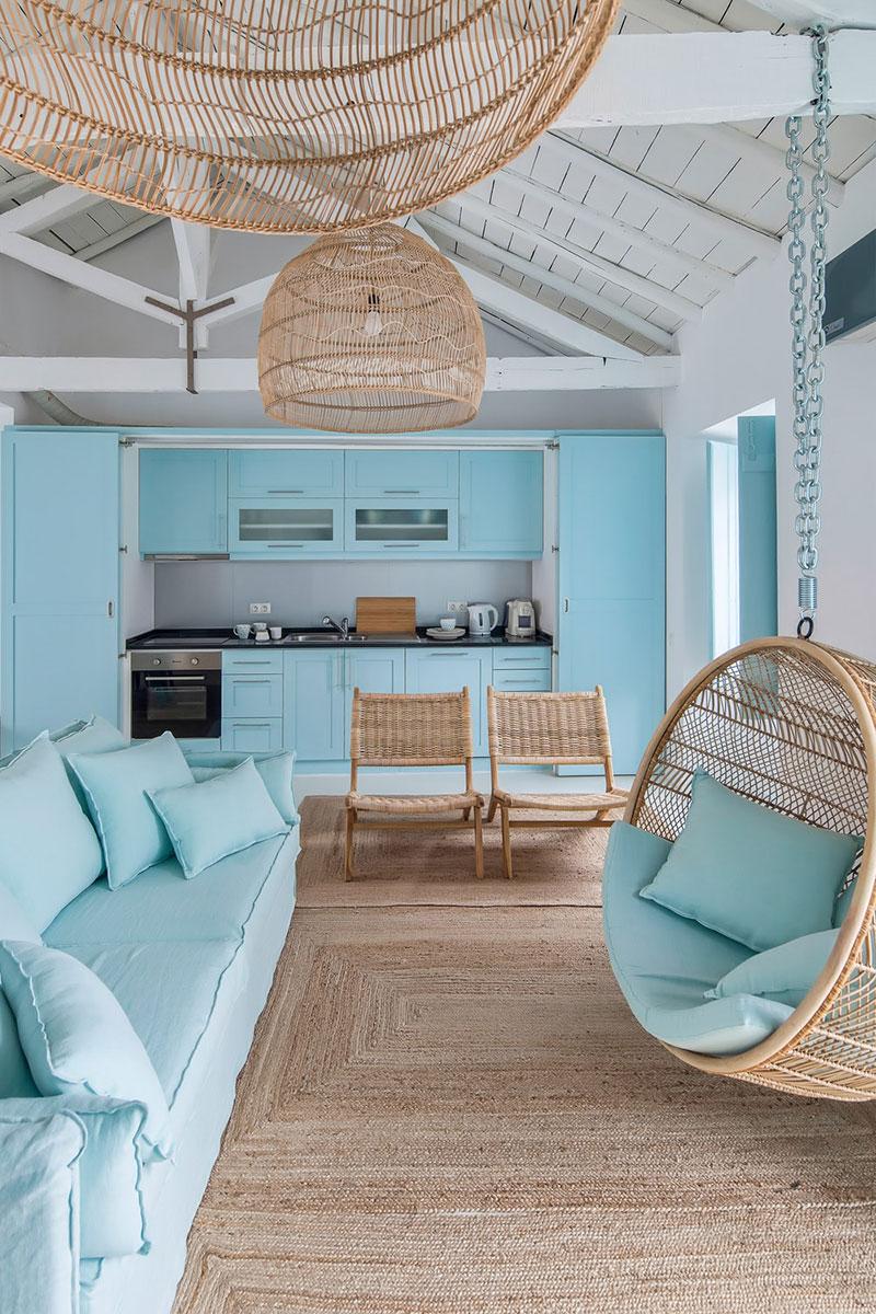 living room, rattan rug, blue sofa, rattan round swing, rattan pendant