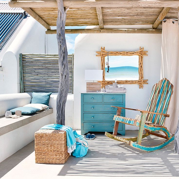 living room, white floor, white wall, blue wooden cabinet, white bench, rattan coffee table, blue wooden rocking chair