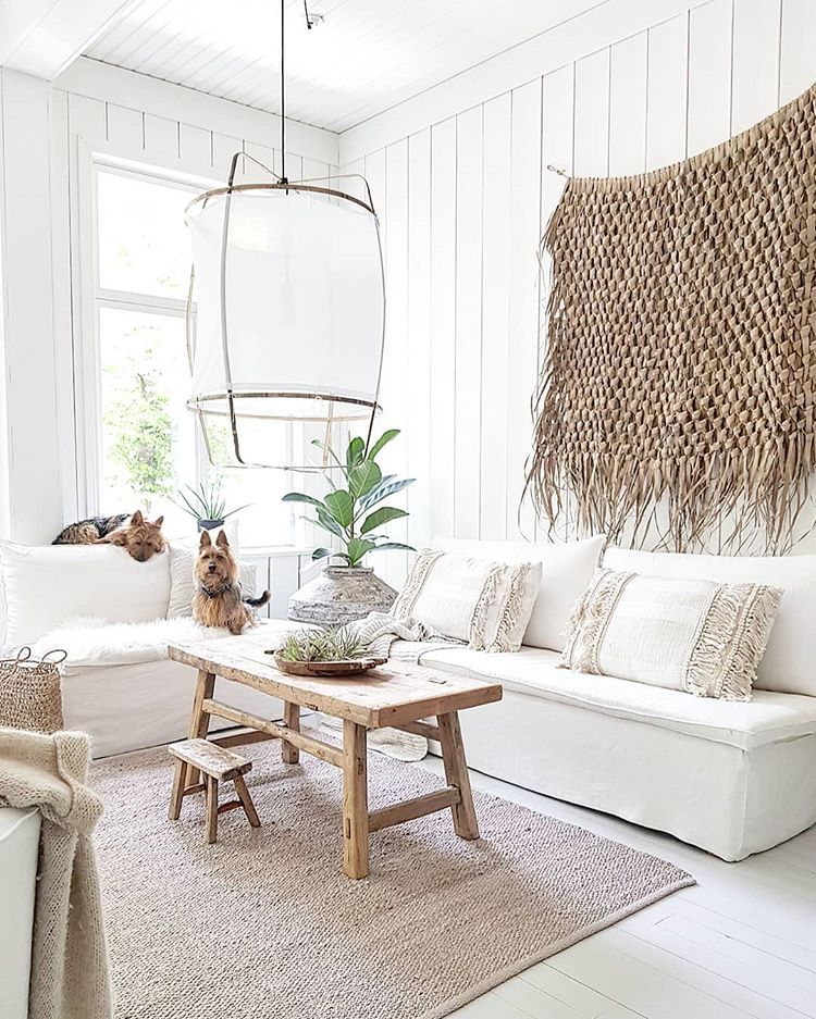 living room, white floor, white wooden wall, white sofa, wooden coffee table, white lantern, white rug