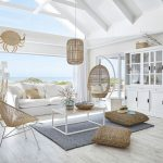 Living Room, White Wooden Floor, White Wall, Large Glass Window, White Sofa, Rattan Chair, Rattan Pendant, Rattan Swing Chair, White Coffee Table