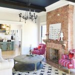 Living Room, Wooden Floor, Expoed Red Brick Fireplace, Round Wooden Coffee Table, Pink Purple Striped Chairs, White Sofa