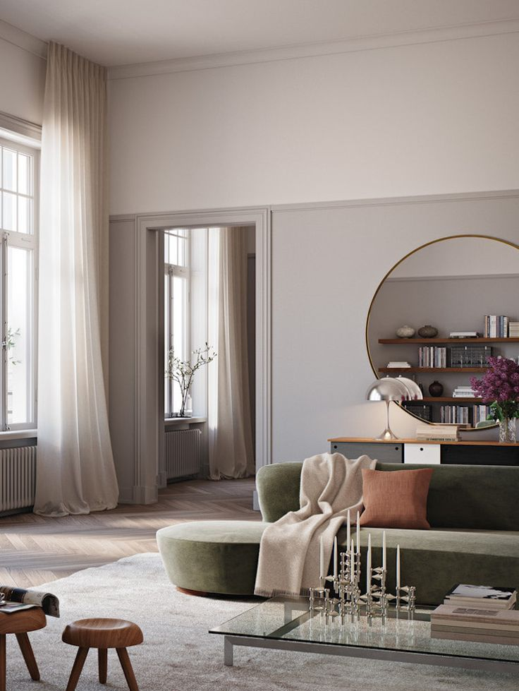 living room, wooden floor, grey rug, white wall, green velvet sofa, glass coffee table, round mirror, black cabinet