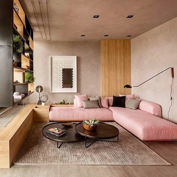 living room, wooden floor, grey seamless wall, wooden accent, pink minimalist sofa, black nesting round coffee table