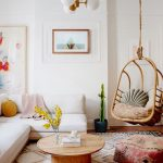 Living Room, Wooden Floor, Patterned Rug, Patterned Ottoman, Wooden Round Coffee Table, White Sofa, White Pendant