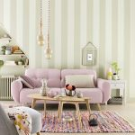 Living Room, Wooden Floor, Striped Wall, Pendants, Purple Sofa, Wooden Coffee Table, Grey Chair, Colorful Rug