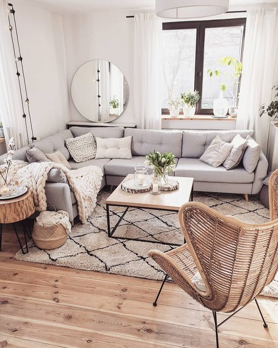 living room, wooden floor, white rug, white sofa, white wall, white curtain, white pendant, wooden coffee table, rattan chair