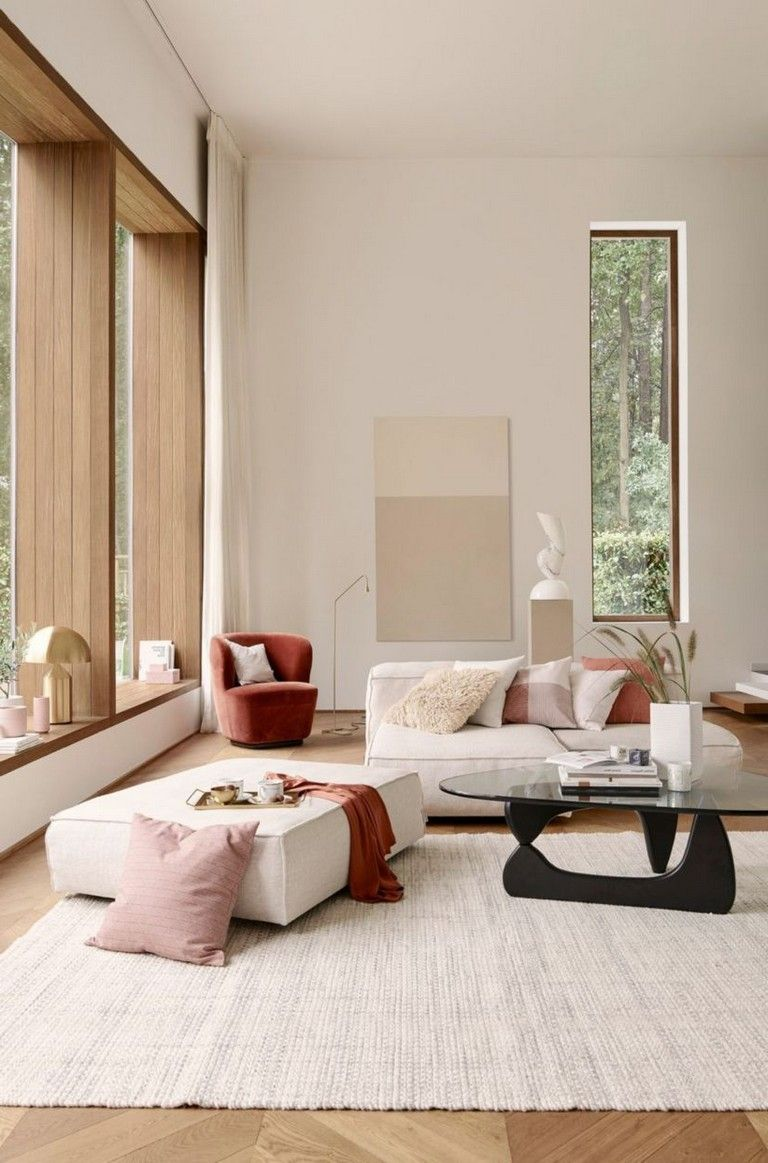 living room, wooden floor, white rug, white wall, white sofa, white ottoman, coffee table, large glass window