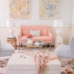 Living Room, Wooden Floor, White Wall, Pink Wainscoting, Blue Chairs, Pink Tufted Sofa, Pink Patterned Rug, Side Table, White Table Lamp