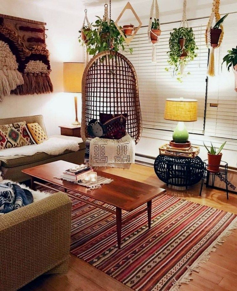 living room, wooden floor, wooden coffee table, rattan swing, brown sofa, patterned rug,