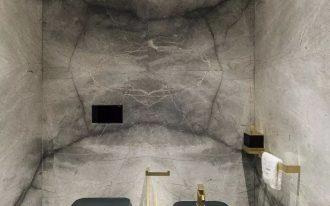 long black floating toilet, matchign sink, golden faucet
