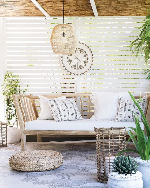 patio, grey floor tiles, white wooden grid, rattan ceiling, rattan pendant, wooden bench, rattan ottoman