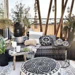 Patio, White Patterned Rug, White Patterned Ottoman, Black Rattan Bench, Black Iron Framed Side Table