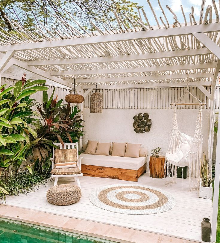patio, wooden floor, white wooden floor, white rattan rug, rattan wooden ceiling, wooden bench, white cushion, white wooden chair, white swing