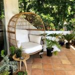 Rattan Chair With White Cushion And Pillows, Wooden Side Table