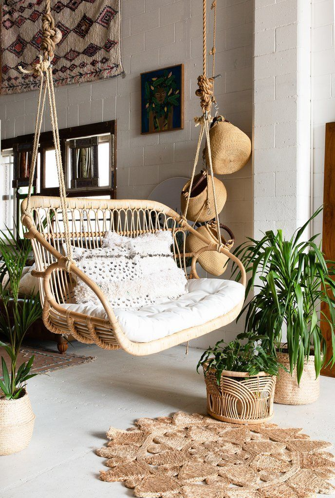 rattan swing for two, white cushion, pillows, white wall