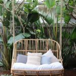Rattan Swing For Two, White Cushion, Pillows, Wooden Floor