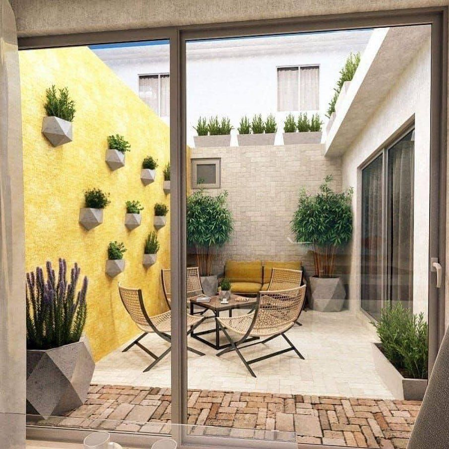 small garden, brick floor, white floor, yellow wall, grey wall, yellow sofa, rattan chairs, table, glass sliding door