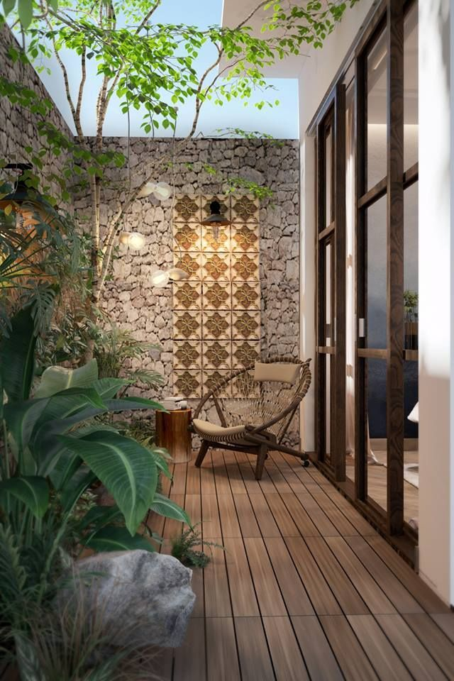 small garden, wooden floor, natural stone wall, plants, rattan lounge chair