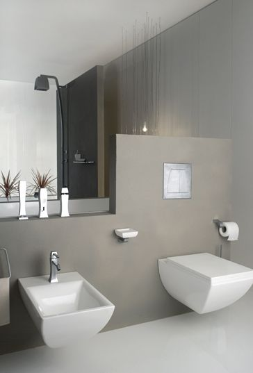 square floating toilet with matching sink, grey wall
