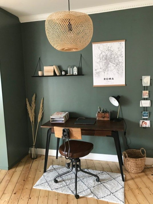 study, wooden floor, green wall, dark wooden table, floating shelves, office chair, rattan pendant