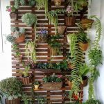 Vertical Garden With Hanging Pots On The Grid