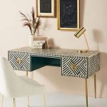 White Black Patterned Table, Drawers, Golden Handler And Legs, White Chair, Golden Table Lamp
