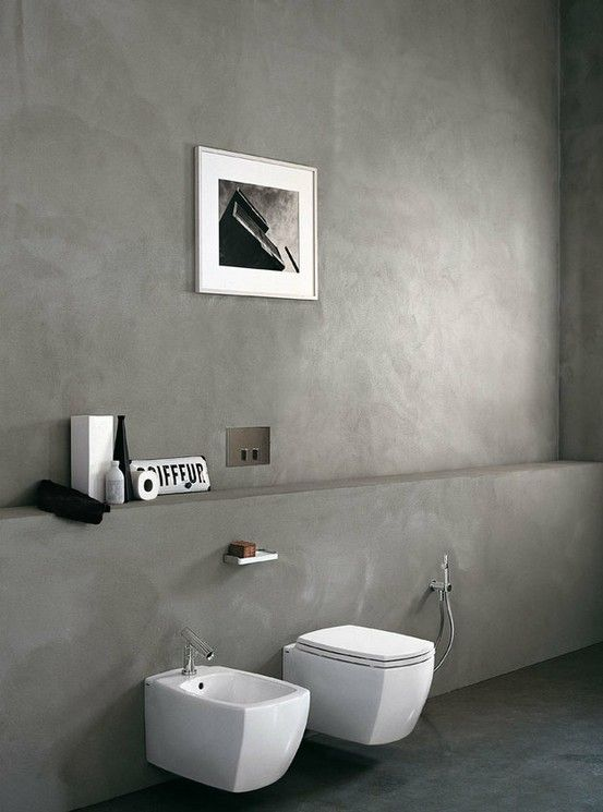 white floating toilet, white sink, grey seamless wall