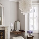 Wooden Floating Desk, White Stool, White Wall, White Chandelier, Marble Fireplace