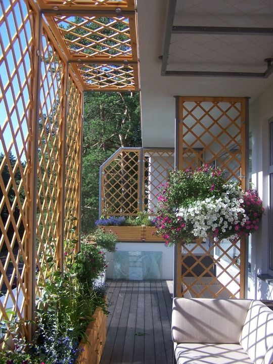 wooden partition, wooden plant pots flowers white sofa