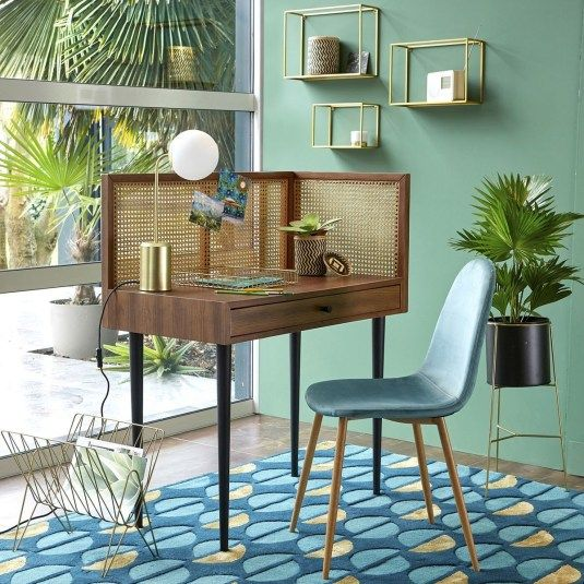 wooden study desk with rattan wooden partition on the side, table lamp, blue chair