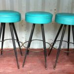 Classic Nice Adorable Small Turquoise Bar Stool With Round Surface And Has Nice Iron Legs Design