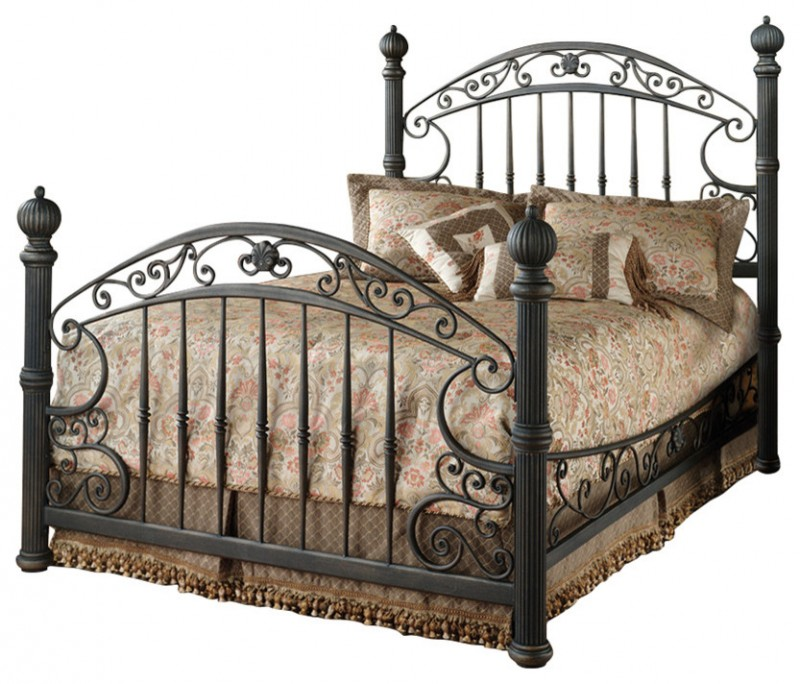 Baroque rustic old brown metal frame bed with ornate head and foot board