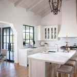 Bright Kitchen With Hardwood Floor Mediterranean Kitchen Design Hardwood Floor Cabinets Countertop Faucet Sink Dining Chairs Wall Cabinet