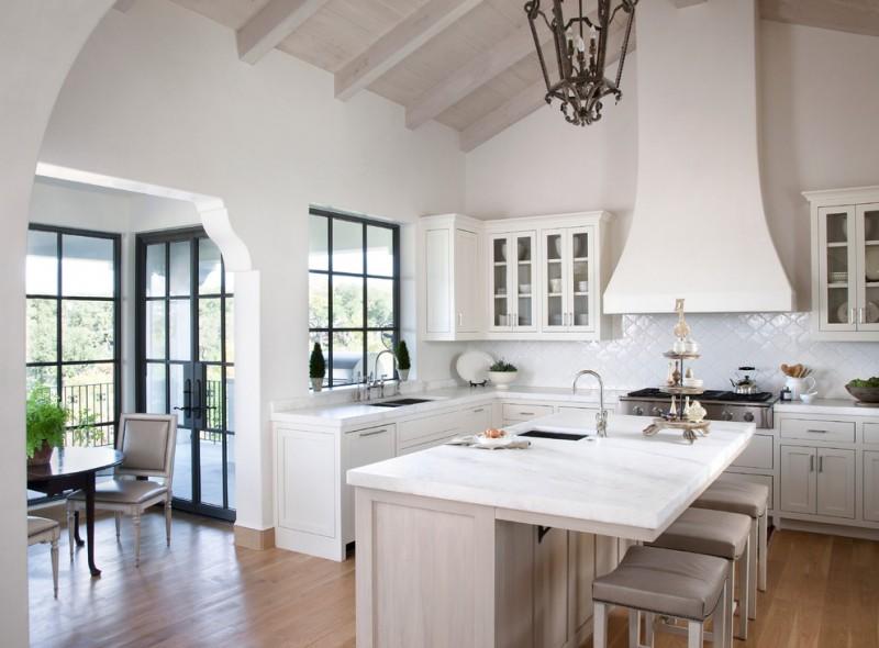 mediterranean kitchen design hardwood floor cabinets countertop faucet sink dining chairs wall cabinet