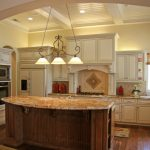 Grand Kitchen With Warm Above Cabinet Lighting