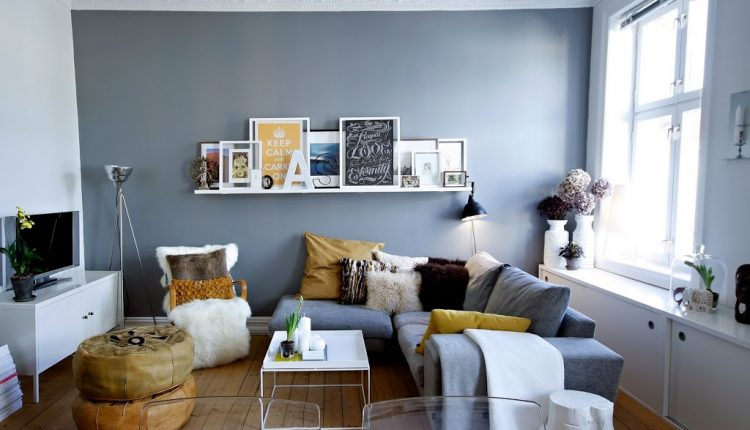 L shaped grey sofa decorative pillows white fury reading chair white square coffee table brown bean bag chair white floating shelf white vintage TV console hardwood flooring idea