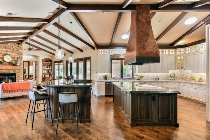 mediterranean kitchen wooden floor dining chairs countertop window cabinets ceiling lamps