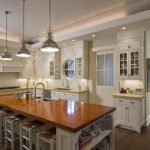 White Wooden Kitchen Cabinet With LED Lighting Above And Under
