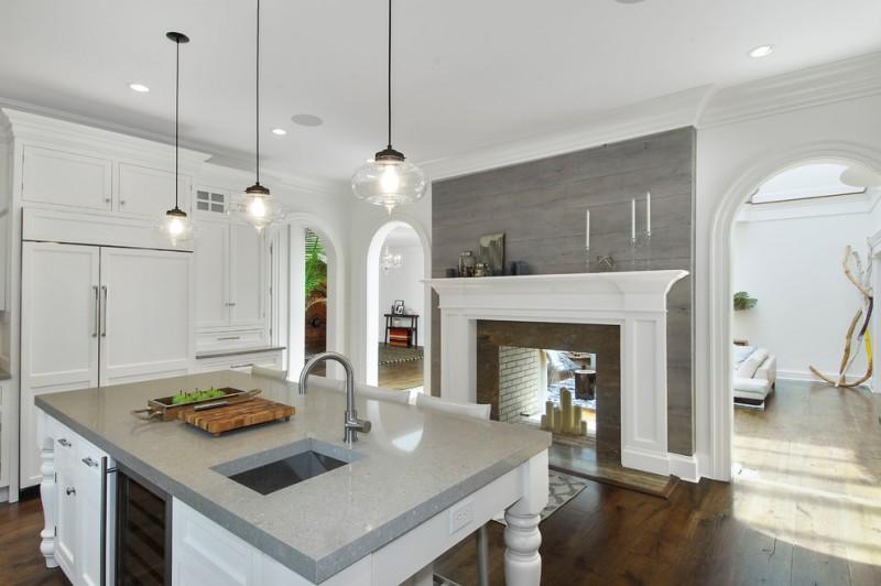 mediterranean kitchen design hardwood floor quartz countertop faucet sink hanging lamps cabinets white ceiling white walls