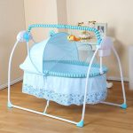 blue cradle crib with toys on top
