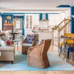 Blue Living Room Ideas Blue Carpet Wooden Floor Blue Walls Paintings Rattan Wall Lamp Sofa Pillow Wall Cabinet Stair