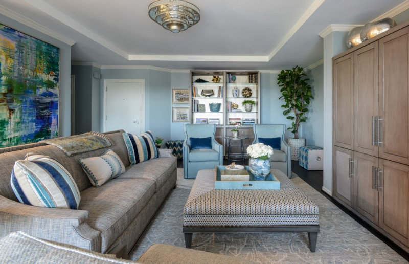 blue living room ideas cabinet painting pillows sofa table vase ceiling lamp door light blue walls