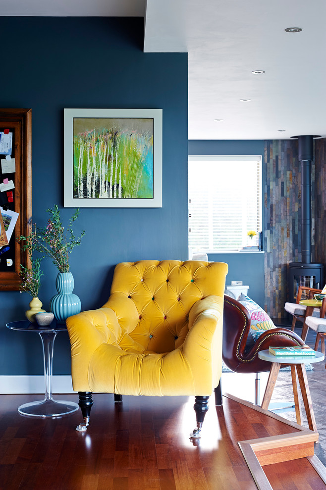 blue living room ideas wood floor yellow tufted chair painting vase small chairs book transparrent table window