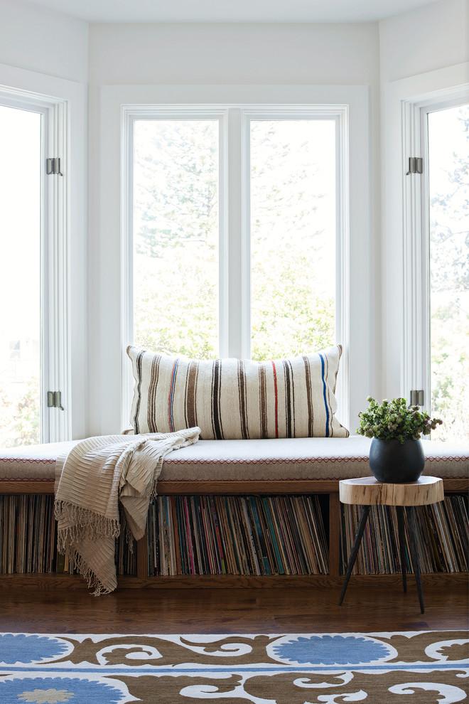 brown wooden chair and vinyl shelf below