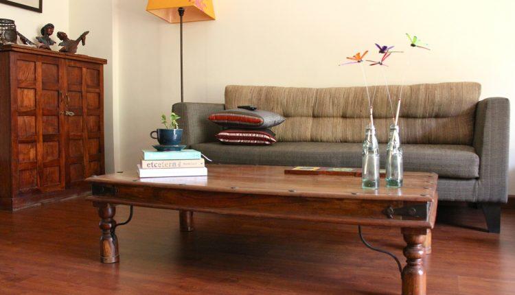 comfy grey sofa hardwood coffee table high feed corner lamp with orange lamp shade