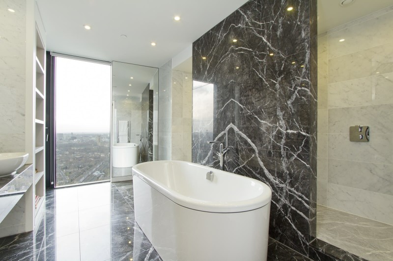 contemporary bathroom facing outdoor dark marble tiles beautifully combined white and black marbles free standing oval bathtub 6 shelf clothingcase