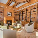 Contemporary Office White Sofas Low Table Carpet Wall Shelves Wooden Shelves Bookshelves Fireplace